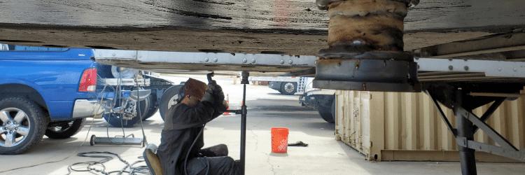 A Welder is Repairing a Kingpin for a Fleet that wants to Reduce Kingpin Wear